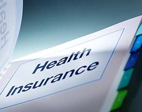 Health insurance is written on the page in a tabbed binder